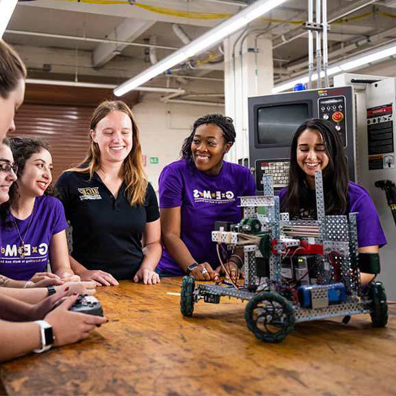 six female ucf students working in engineering lab